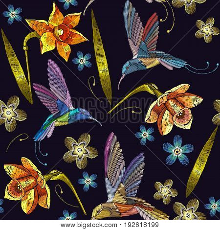 Humming bird and yellow narcissuses embroidery exotic tropical flowers seamless pattern. Beautiful flowers embroidery humming-bird orchids tropical flowers