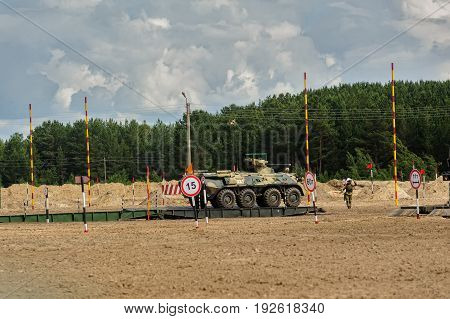 Tyumen, Russia - June 21, 2017: Army Games. Safe Route contest. Motion of BTR-82 amphibious armoured personnel carrier on mechanized bridge