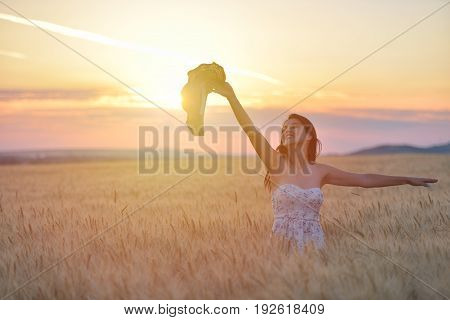 Closeup Portrait Of Smiling Young Caucasian Woman In Nature. Cheerful Young Beautiful Woman Enjoying