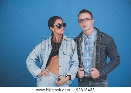 fashion. stylish woman and man in sunglasses glasses and jeans jacket on blue background denim style beauty and fashion summer couple in love student lifestyle