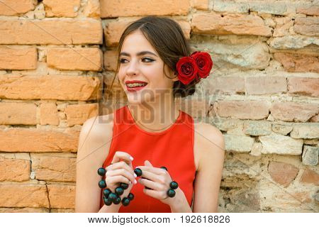 Girl Smiling With Dental Braces On Teeth