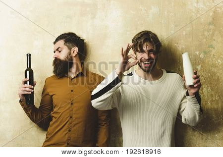 Hipster Looking At Wine Bottle And Happy Man With Yogurt