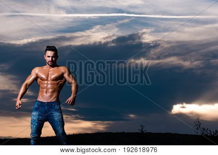 Bodybuilder With Muscular Body On Blue Sky