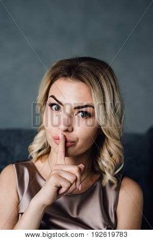 bright closeup picture of Surprised woman with hand over mouth