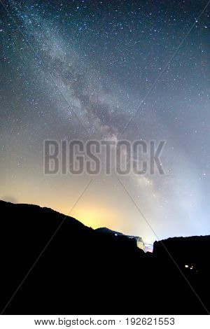 Milky Way over the Meteora Greece. long exposure. Image contain noise blur due to slow shutter speed.