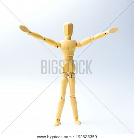 Wooden figure doll with Stretch arms to hug for peace concept.