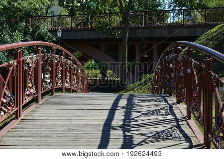 The bridge in the park Grodno hung with hundreds of locks symbolizing oath of eternal love and fidelity of the young couple
