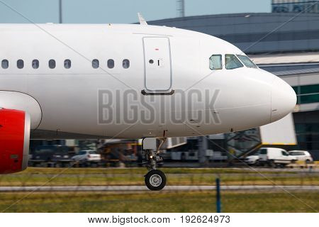 Close up with white airplane nose during take off