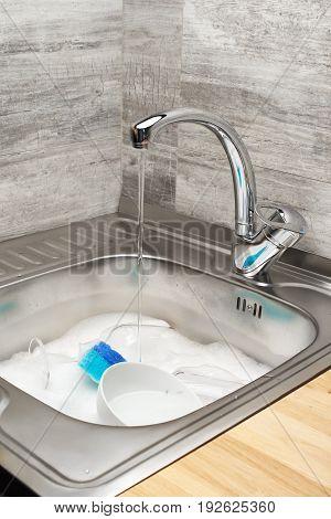Kitchen Sink With Water, Foam, Tableware, Blue Cleaning Sponge