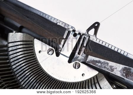 Typewriter with a white sheet of paper close up