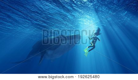 Female diver in danger near a whale underwater. This is a 3d render illustration