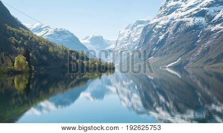 Beautiful panorama of idyllic Norwegian nature at dawn