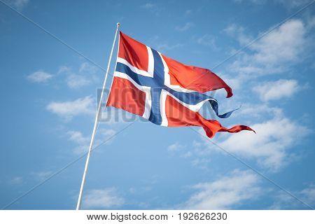Norwegian flag waving in the wind, Oslo