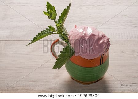 Homemade Strawberry Ice Cream In A Cup And Mint