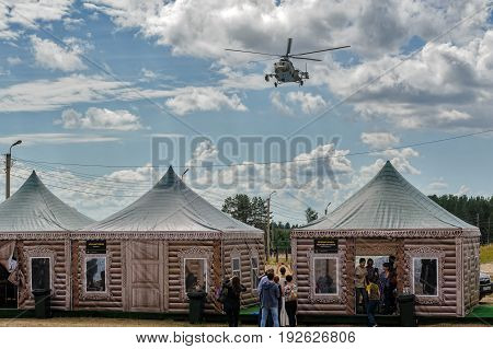 Russian Military Helicopter Mi-8 Over Camp