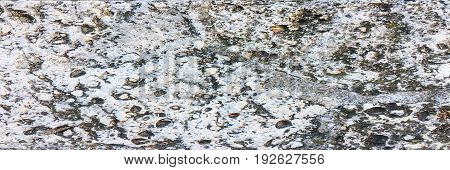 Colorful natural stone background texture.Stone texture background.Close up of a stone texture background.Details of sand stone texture.The detail texture of stone.