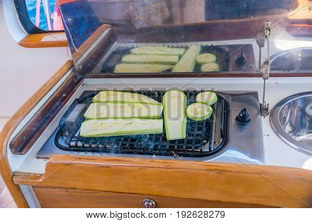 Courgettes zucchini are fried while sailing on a yacht.