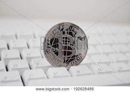 Silver Bitcoin On The Keyboard