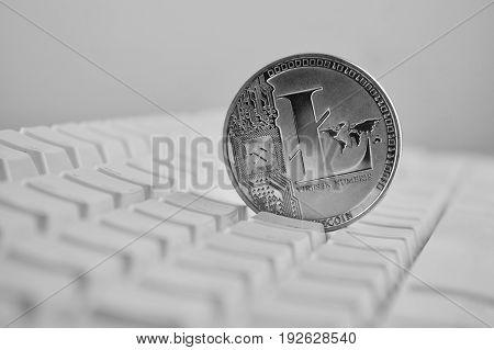 Litecoin On White Keyboard