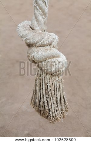 A thick rope made of cotton yarn for sports. Tied down at the knot