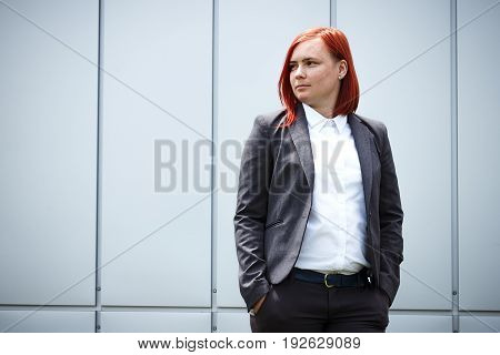 Serious Successful Red-haired Girl Boss, Businesswoman In Suit, With Space For Text And Advertising