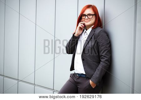 Success! Victory! Happy Successful Red-haired Girl Boss, Businesswoman In Suit And Glasses Speaks On