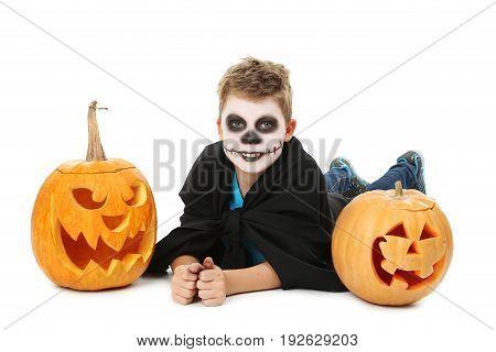 Little Boy In Halloween Costume With Pumpkin On White Background