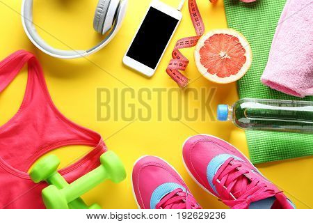 Fitness equipment on yellow background, close up