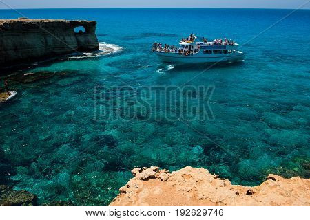 Tourist Boat Approaching The Sea Caves Of Ayia Napa