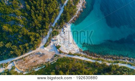 Aerial view of Marble beach. The most beautiful white beach in Greece