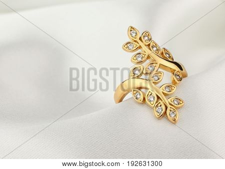 jewelry ring with diamonds on white cloth