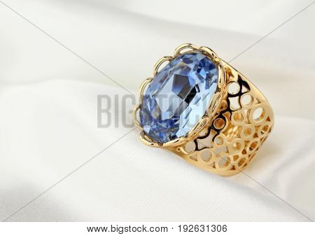 jewelry ring with big gem on white cloth
