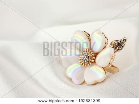 jewelry ring with pearl on white cloth