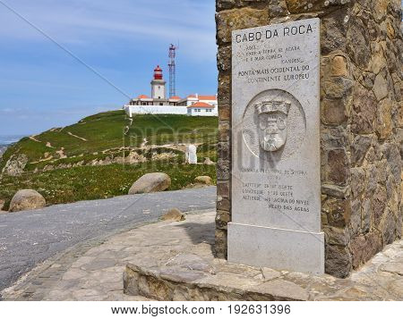 Cabo da Roca, Portugal - June 03, 2017: Monument in the Cabo da Roca the western point of Europe Portugal. Cabo da Roca Lighthouse on background
