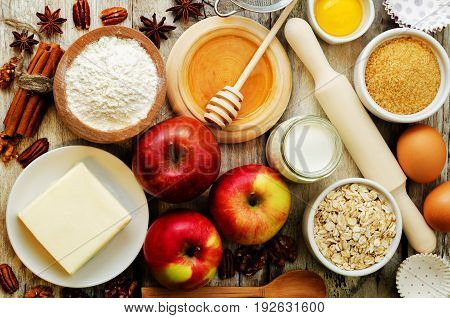 baking ingredients: apples nuts honey flour and butter