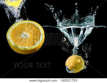 Splash Water With Droping Lemon And Slice Piece