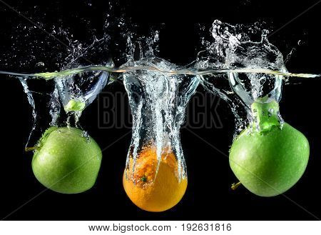 Splash Water With Droping Oranges And Apples