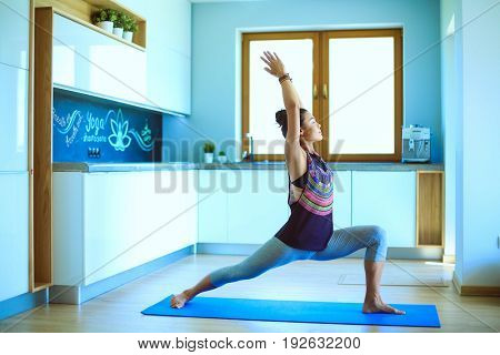 Asian woman are yoga exercises at home. Woman. Yoga.