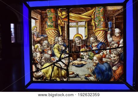 Sintra, Portugal - June 06, 2017: Stunning stained glass window on the wall in the palace of Pena Sintra Portugal. Colored pictures from the history of Portugal people in the tavern