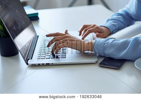 Business woman working behind laptop, business woman typing, phone, laptop, work.