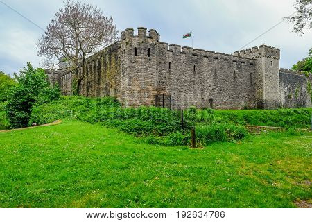 Cardiff Wales - May 20 2017: View of Cardiff Castle from Bute Park with Welsh flag flying high.
