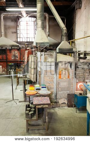 Craftsmanship of glass. Glass furnace viewMurano VeniceItaly.