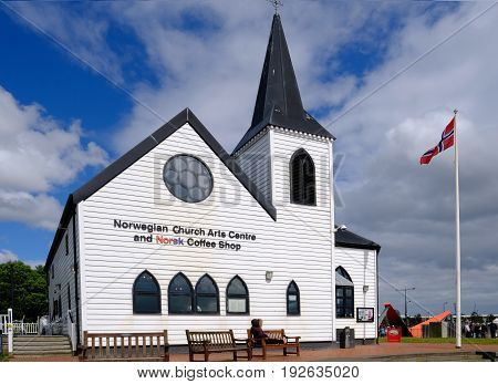 Cardiff Bay Cardiff Wales - May 20 2017: Norwegian Church and arts centre. Norwegian flag flying.