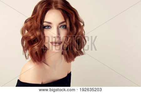 Beautiful model girl  with short   red  curly hair