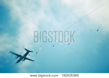 The group of parachuters had just jumped out of a plane.