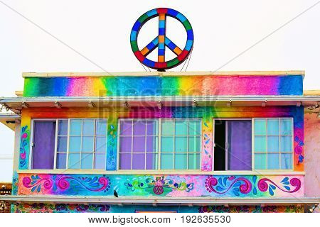 June 21, 2017 in Ocean Beach, CA:  Bohemian style colorful Hosteling International Building with a Peace Sign taken in Ocean Beach, CA where visitors can stay here and experience a hippie lifestyle in a liberal community
