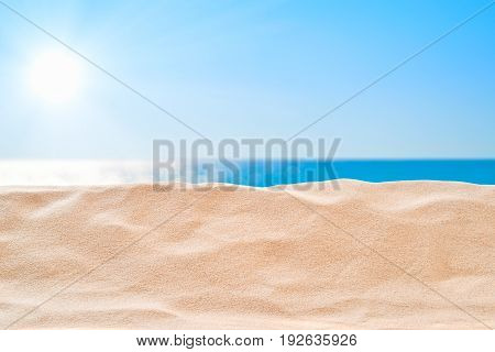 On the Beach - sand dune in front of beautiful azure sea on a sunny day