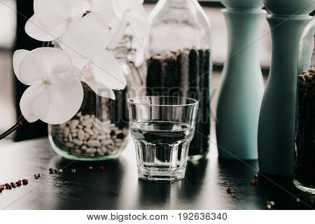 Glass of water. Healthy lifestyle. Flower blurred blackground. Fitness and Losing weight. Diet and Proper nutrition. Vintage toning photo