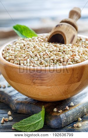 Green Buckwheat With Wooden Scoop In Bowl.