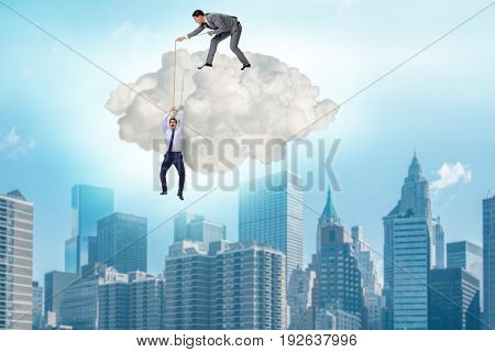 Businessman saving colleague by pulling rope